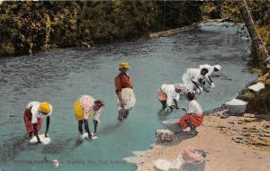 Jamaica Port Antonio    Women washing clothes in river