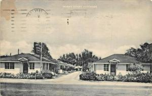 ST PETERSBURG FLORIDA~MORAY COURTS MOTEL COTTAGES~1951 PSMK PHOTO POSTCARD