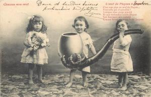 Little girls with father`s huge pipe surrealism 1905 fantasy