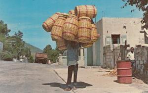 PANIER, Haiti, West Indies, 40-60s; Man holding baskets on head