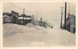 Valdez AK Snowy Street View Store Fronts, in 1916  RPPC Postcard