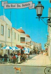 Postcard Portugal Vila real sto antonio street view restaurant terrace dog city