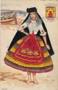 NAZARE, Portugal, 1930-40s; Woman in embroidered dress, Leiria coat of arms