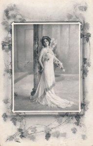 Woman wearing long gown posing by column, Ivy, PU-1912