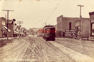 MAIN ST. WINNECONNE, WI dirt roads Trolley superimposed? in front of Geo. Marin