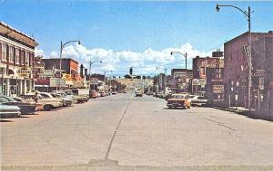 Greybull WY Yellowstone Park Store Fronts Old Cars Postcard