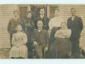 Bent Pre-1907 rppc PRETTY GIRL WITH BOW IN HAIR WITH ELDERS OUTSIDE HOUSE r6514