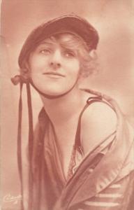 Woman in cap , bare shoulder , 00-10s ; TUCK