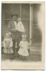 012013 RPPC Real Photo Postcard Father and Children by Porch circa 1910