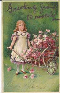 Girl with wheel barrel full of pink flowers , 00-10s
