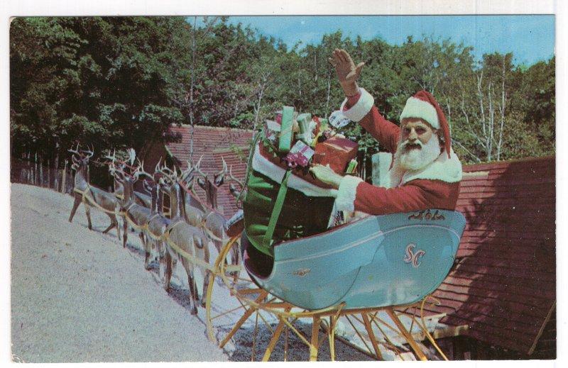 North Pole, N.Y., Santa Greets you from his sleigh at Santa's Workshop
