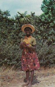 JAMAICA , W.I. 1950-60s; Fruit Vendor, Carrying bananas on head