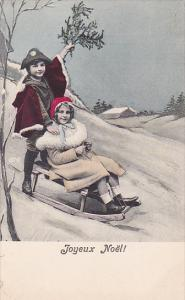 Joyeux Noel, Boy and girl playing in sleigh in the snow, 00-10s