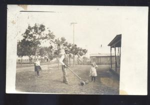 RPPC DOWNS KANSAS RESIDENCE LAWNMOWER LAWN MOWING REAL PHOTO POSTCARD