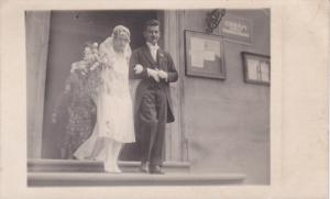 RP; Newlyweds exiting building, 1950s