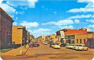 Rawlins WY Business Section Storefronts Old Cars Postcard