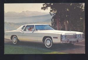 1977 CADILLAC VINTAGE CAR DEALER ADVERTISING POSTCARD '77 CADDY