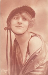 Woman in cap , bare shoulder , 00-10s ; TUCK