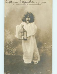 1904 rppc foreign PRETTY GIRL WITH LANTERN HUSHES WITH FINGER ON LIPS r6400