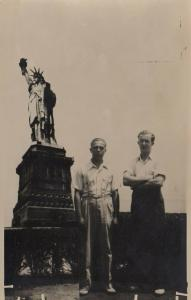 RP: NEW YORK CITY, New York, 1930-50s;Two men standing next to Statue of Liberty