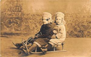 Boy and Girl On Vintage Sled Winter Clothes Real Photo RPPC Postcard