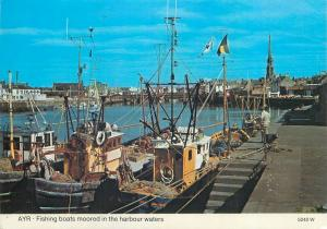 Fishing boats moored in the harbour waters Ayr