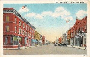 F48/ Miles City Montana Postcard c1920s Main Street Stores Autos
