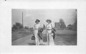 Elkhart Indiana~2 Ladies Walking on Road w Luggage Going Our Way~1914 RPPC