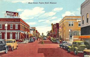 Poplar Bluff MO Street View Coca-Cola Billboard Store Fronts Old Cars Postcard