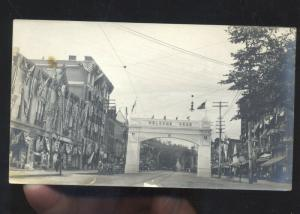 RPPC DOWNTOWN STREET SCENE WELCOME ARCH VINTAGE REAL PHOTO PHOTOGRAPH