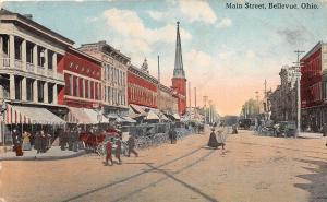 D55/ Bellevue Ohio Postcard 1915 Main Street Crowds Stores
