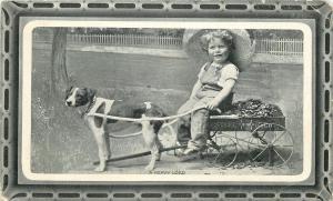 A Heavy Load~Dog Pulls Farm Girl in Steel Gray Brand Toy Wagon~1911 Postcard