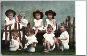 MULTIPLE BABIES w/ HATS & POTTIES UNTIQUE UNDIVIDED POSTCARD
