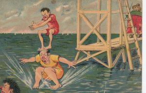 Skinny man standing on bald man on the water, diving tower, Fisherman, 1900-10s