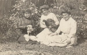 RP: CLEVELAND , Ohio , 1909 ; Girls Posing with chickens