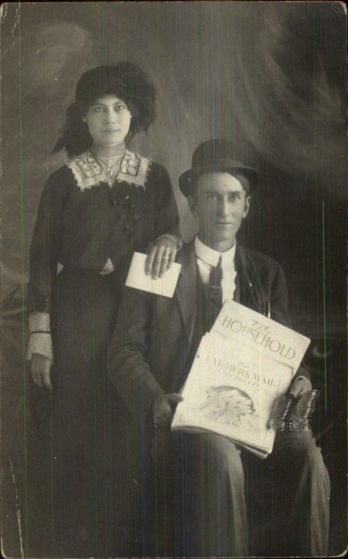 Salesman? Holding Multiple Eyeglasses & Magazines Real Photo Postcard c1910