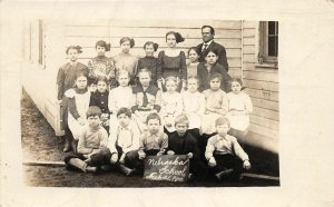 G32/ Nebraska RPPC Postcard 1913 School Building Students Teacher
