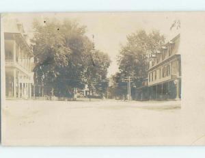 c1910 rppc SHOPS AND BUILDINGS ALONG STREET IN UNKNOWN TOWN HM0487