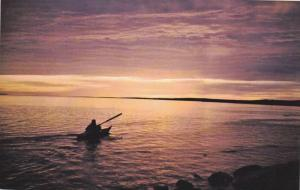 Eskimo Paddling into the Artic sunset , Canada , 40-60s
