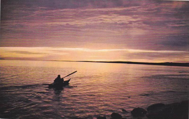 Eskimo Paddling into the Artic sunset , Canada , 40-60s