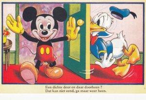 Disney ; Mickey Mouse flings door open into Donald Duck's face , 1959
