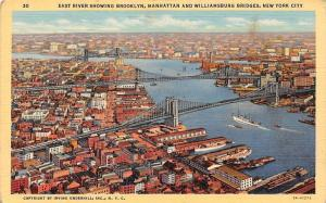 US New York City, East River showing Brooklyn, Manhattan and Williamsburg Bridge