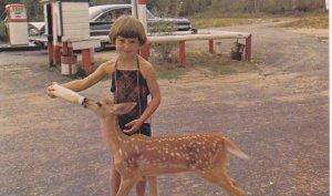 WHITESHELL , Manitoba , 1950-60s ; Faloma Beach , Falcon Lake , Girl feeds a ...