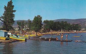 Visitors enjoying a beautiful day at Skaha Lake Beach, British Columbia, Cana...
