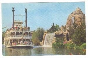The Mark Twain Steamboat passes Cascade Peak, Disneyland,40-60s