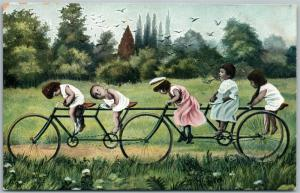 MULTIPLE BABIES on LONG BICYCLE ANTIQUE POSTCARD