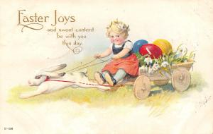 Easter~Lil Blonde Girl Drives White Bunny Rabbit Cart~Colored Eggs~Emboss~E-108