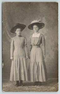 RPPC~Lovely Ladies w/Hats~Sisters? Look Uncomfortable With the Whole Thing~c1910