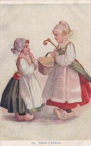 Dutch Children #65, Girl w/ Umbrella & Basket Talking to Smaller Girl 1907