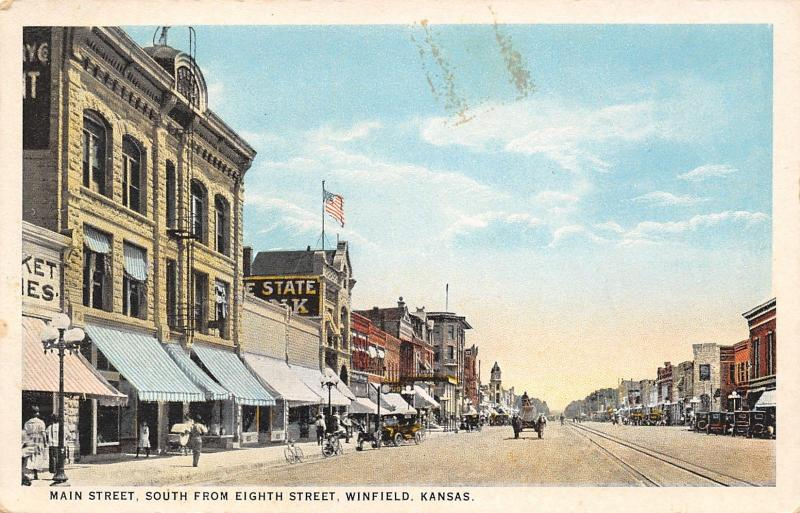 Winfield Kansas~Main Street~Market~Bank~Bicycles on Curb~Baby Carriage~1916 PC